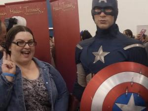 Danielle Smith poses with a wax figure of Captain America
