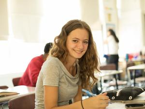Female student smiling at camera