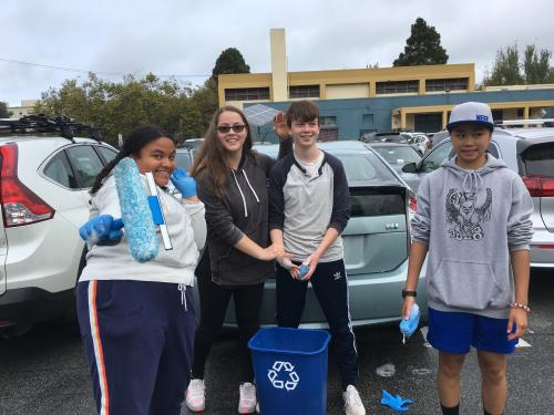 Student participate in a car wash for charity